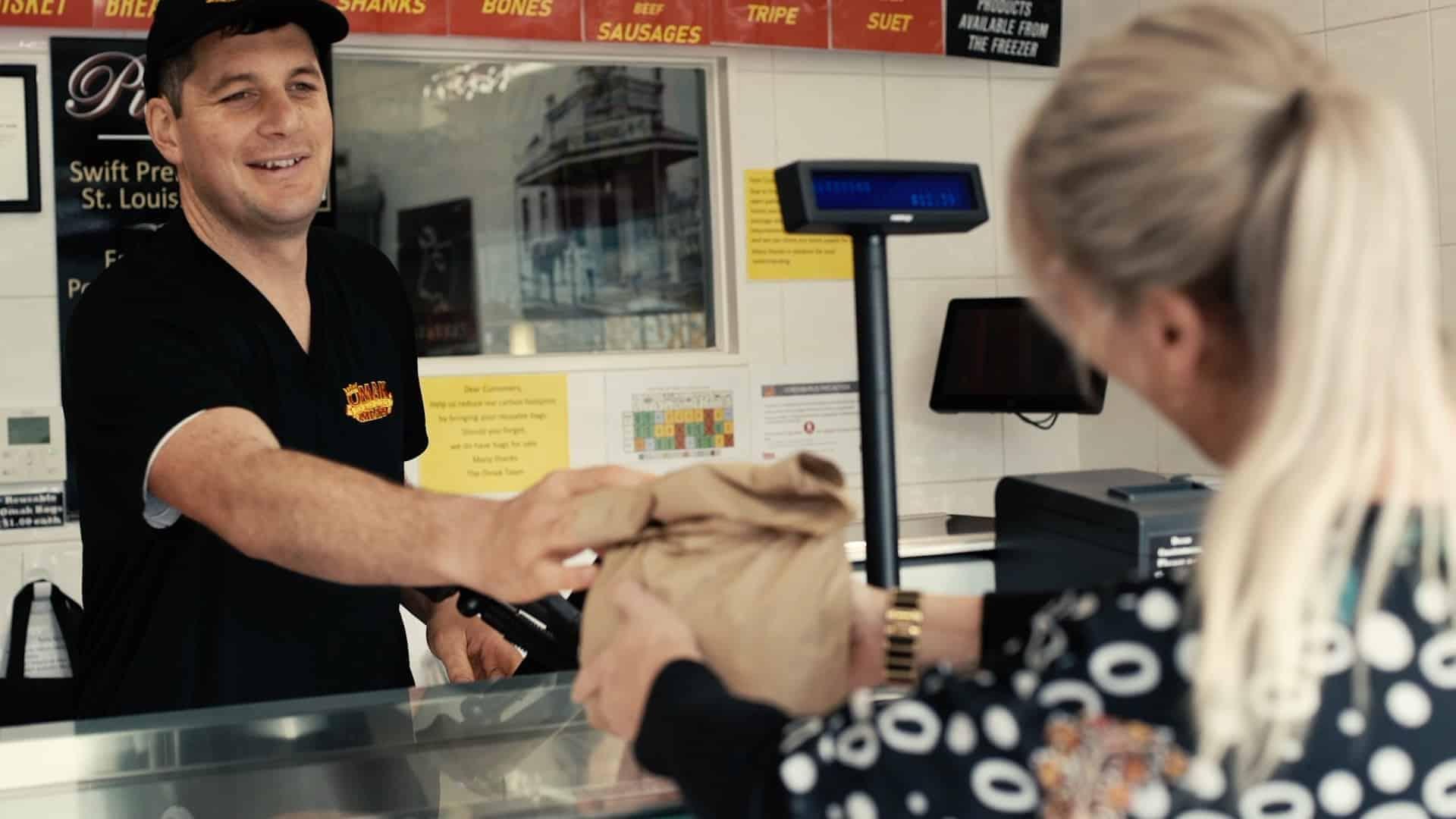 Omak Meats staff serving a customer